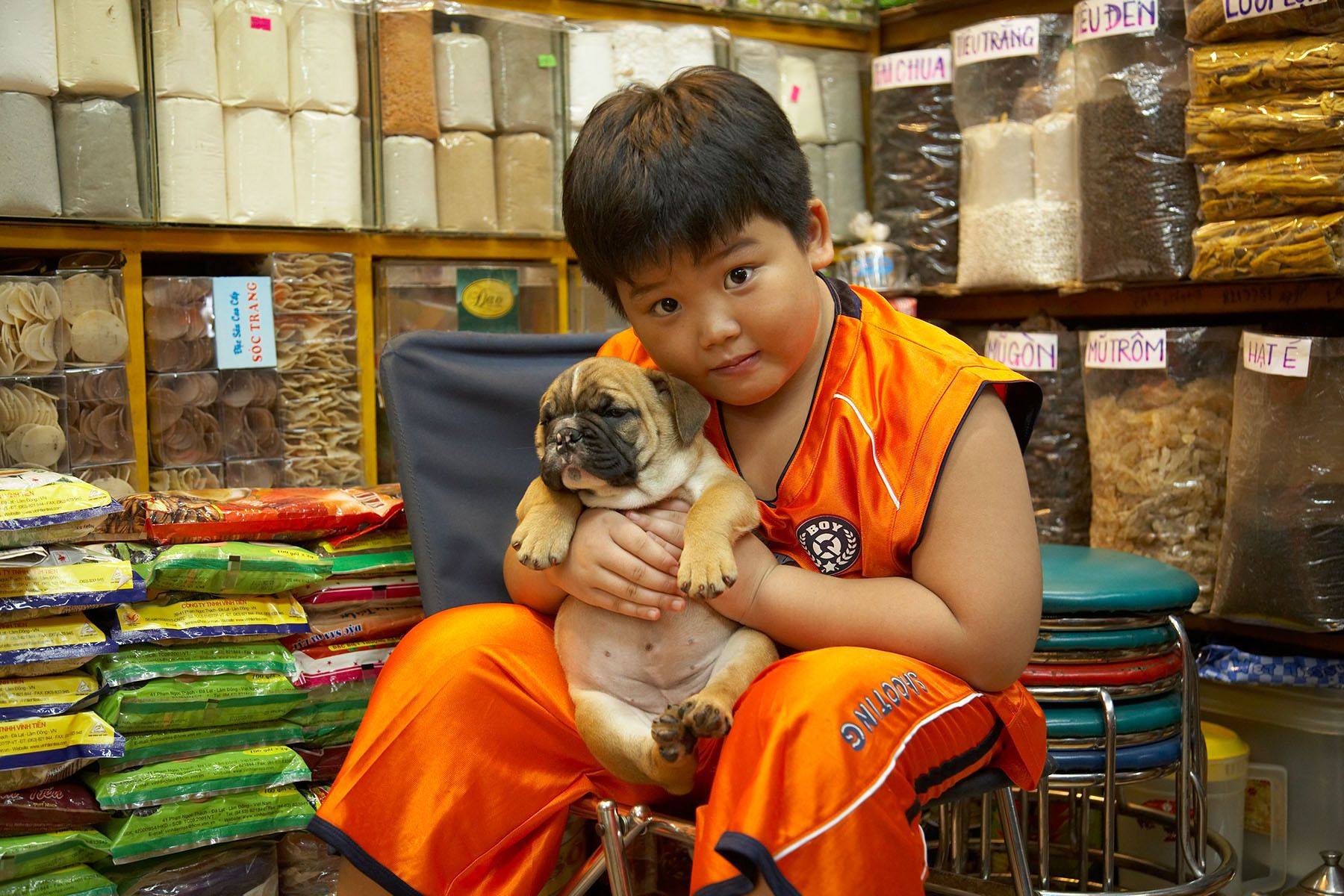 A boy and his pup in Ben Thanh market