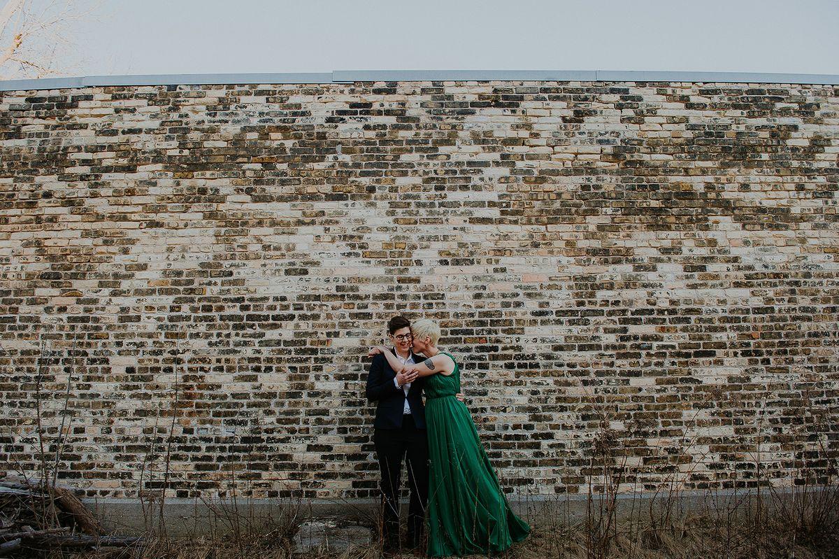 Bride and Groom Against Brick Wall - CampBride