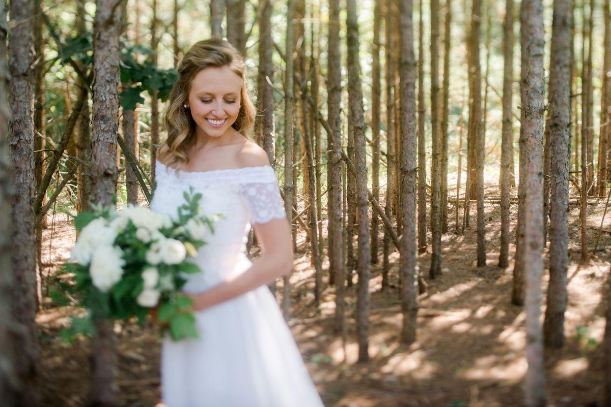 Bride Smiling in Trees - CampBride