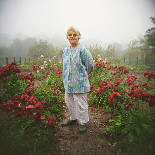 my mother, Anita, in her garden. France