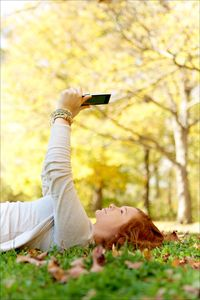 1girl_laying_in_grass_with_ipad_copy