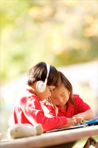1boy_and_girl_with_ipad_copy