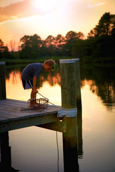 Mason-with-crab-trap-at-sunset.jpg