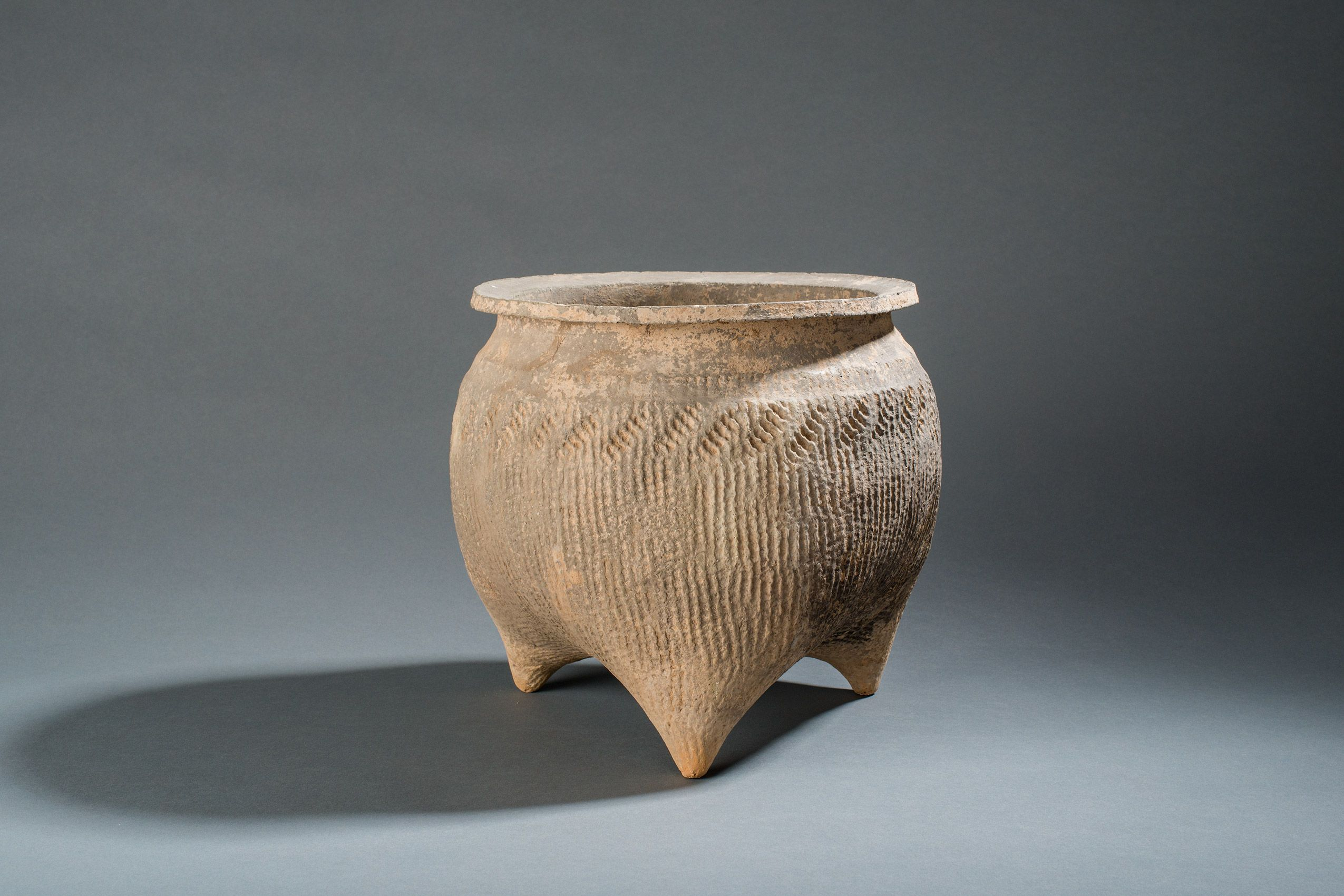 Carved earthenware pot