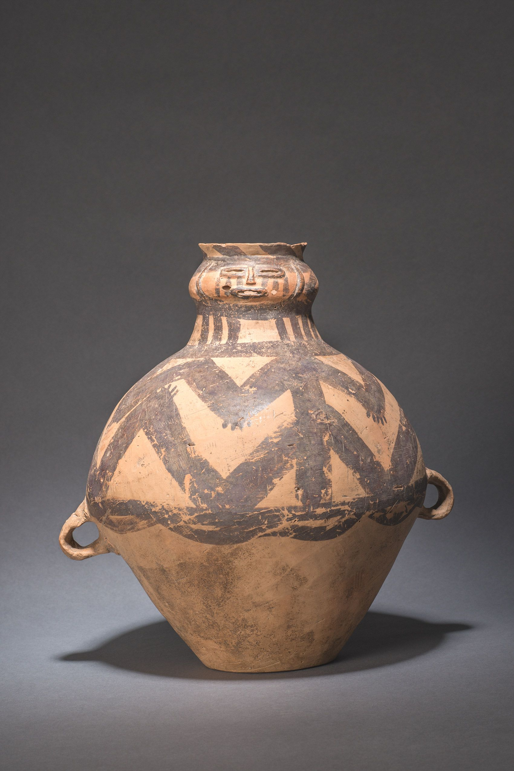 Painted Pottery Jar With Human Face