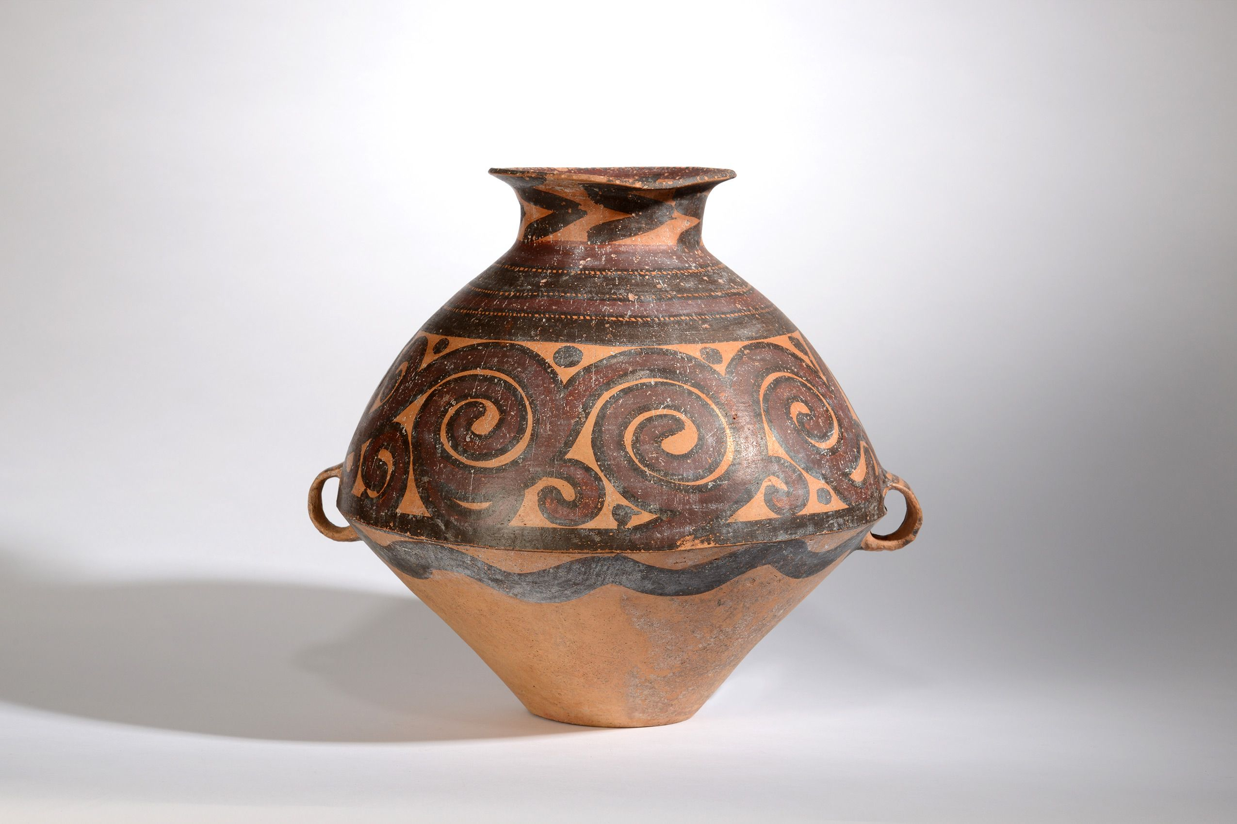 Spiral painted earthenware pot