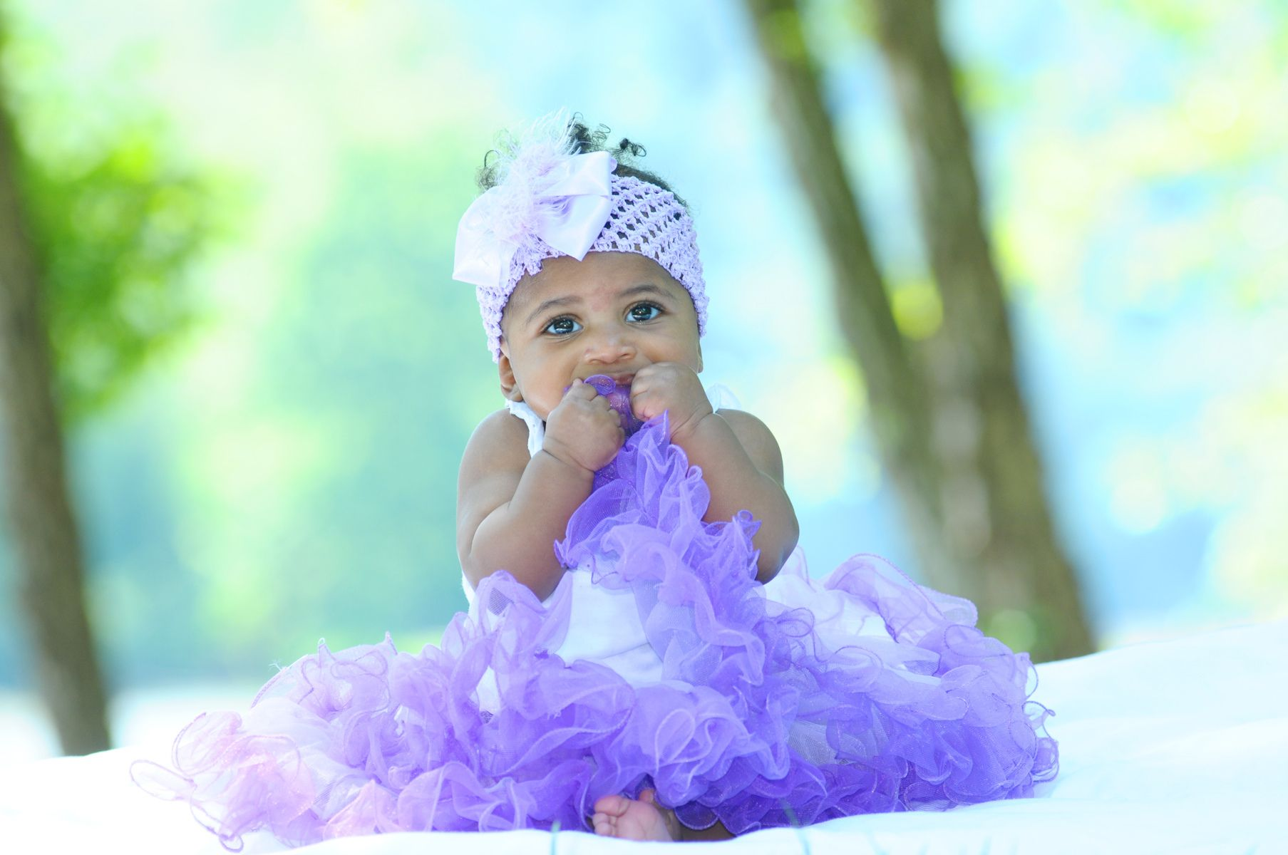 1girl_female_purple_skirt_purple_skirt_lake_baby