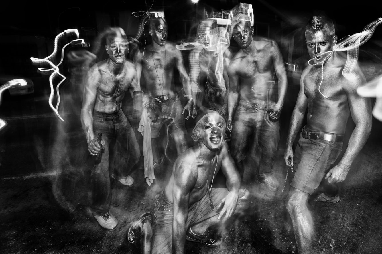 Silver revelers during J'ouvert morning covered in Silver Paint.