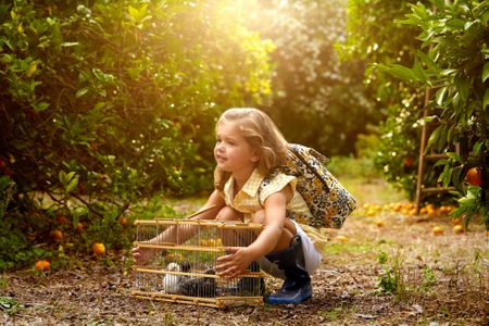 VB Little girl with birdcage.jpg