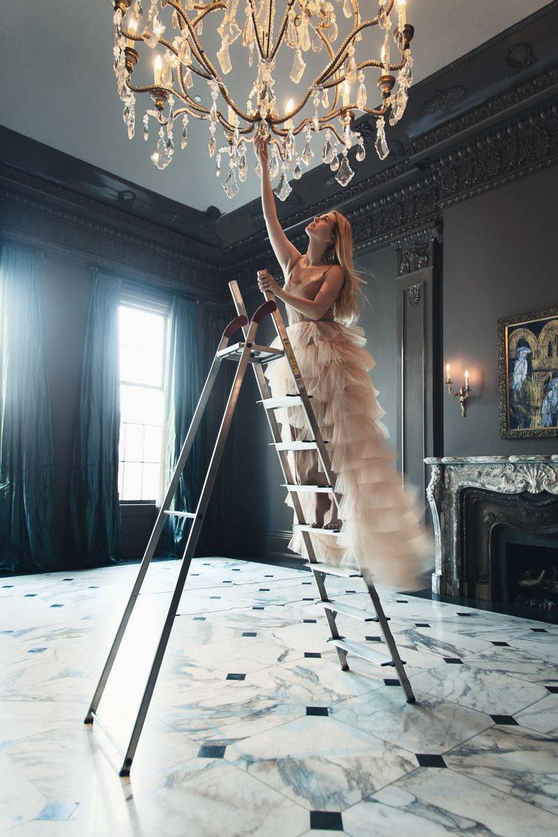 hanging from the chandelier