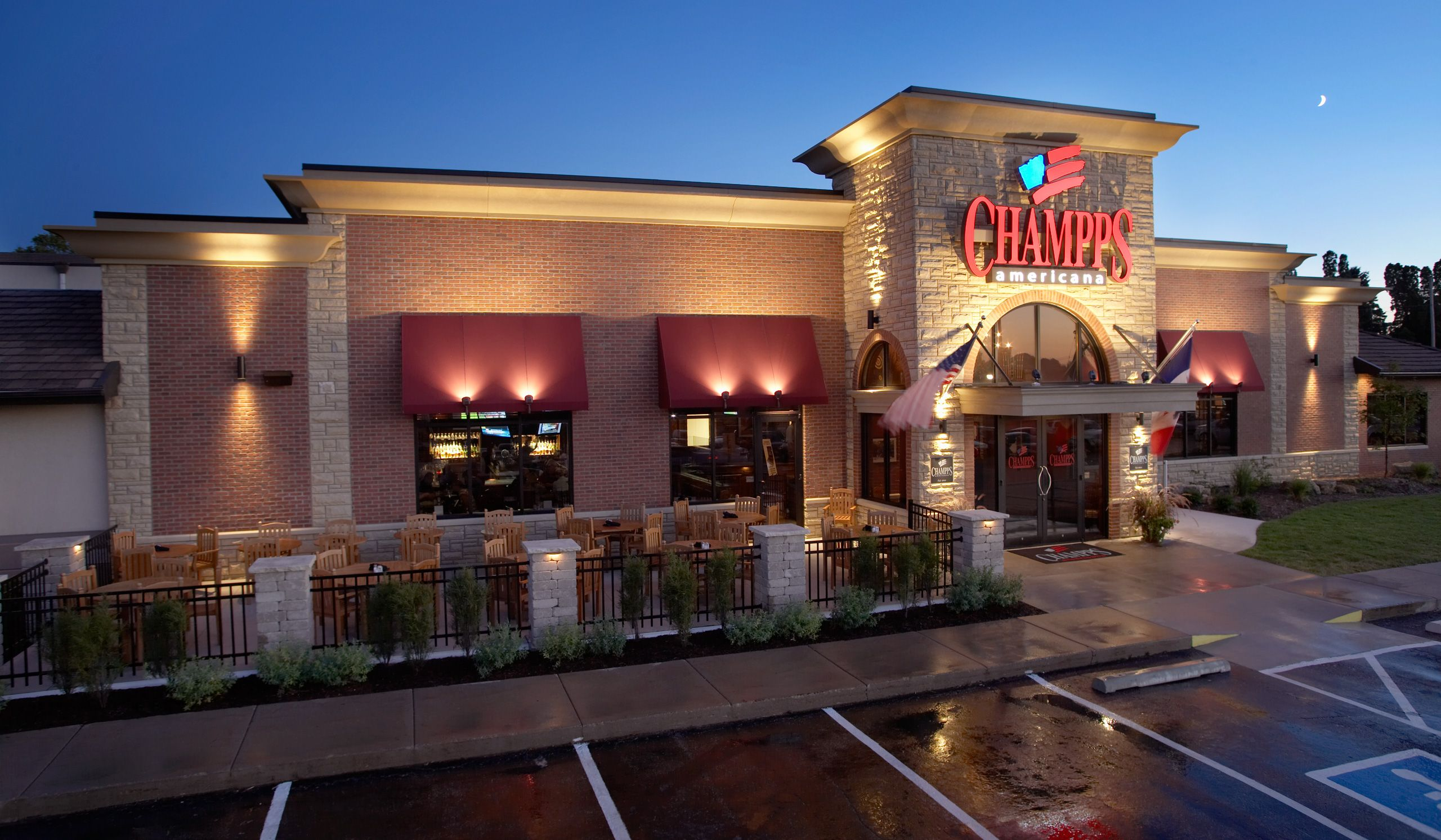 The front of Champps Americana Restaurant  at dusk