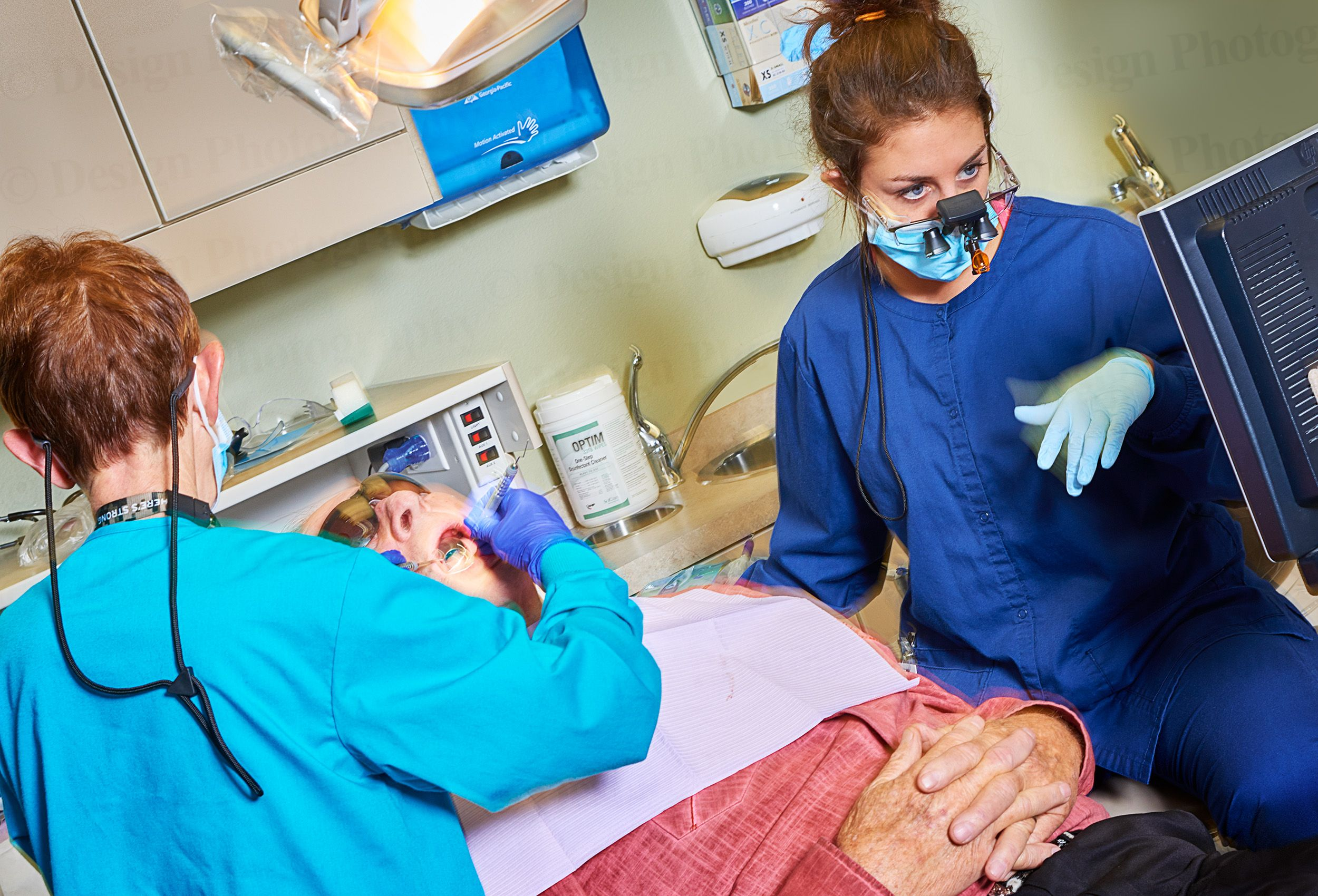 Dental hygienist teacher and student working on a patient at Hawkeye Community College