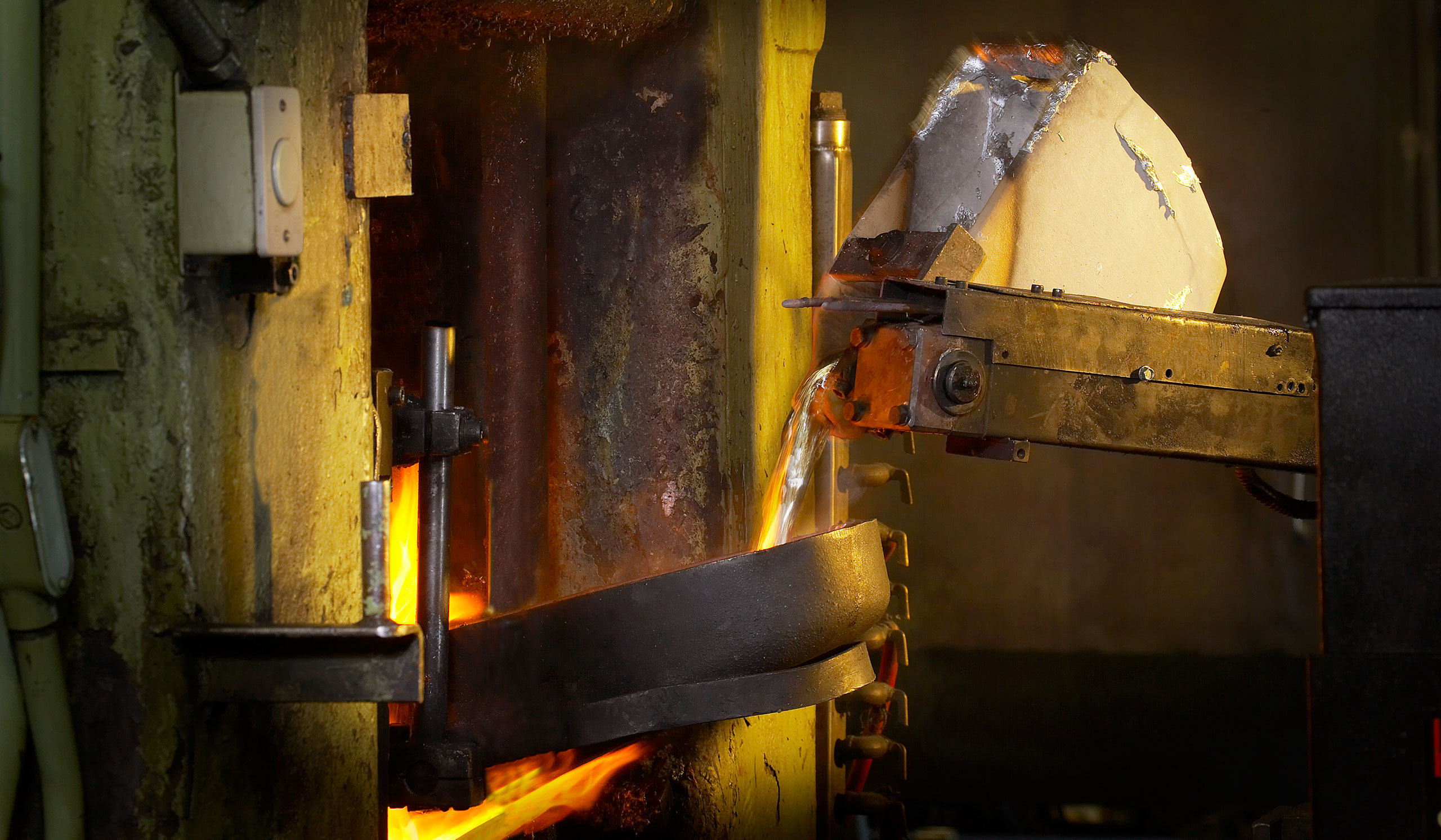 Molten material pouring from hopper in Foundry