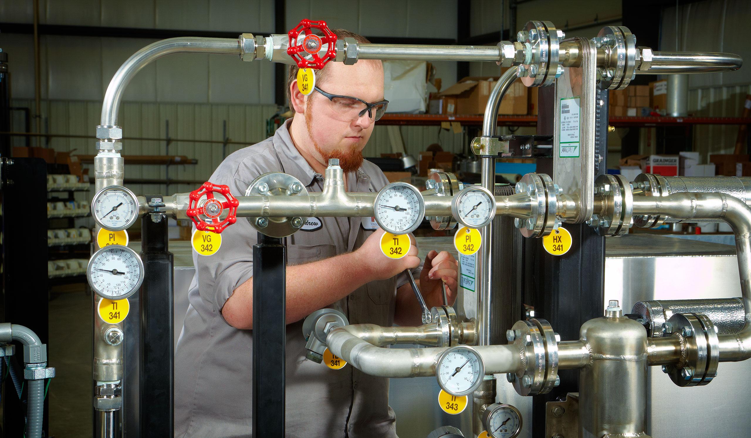 Installing gauges on biogas tanks at Unison Solutions