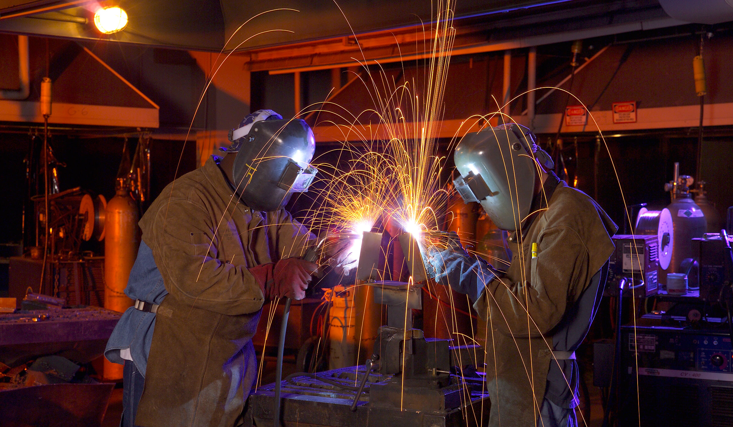 Students welding in class at Hawkeye Community College