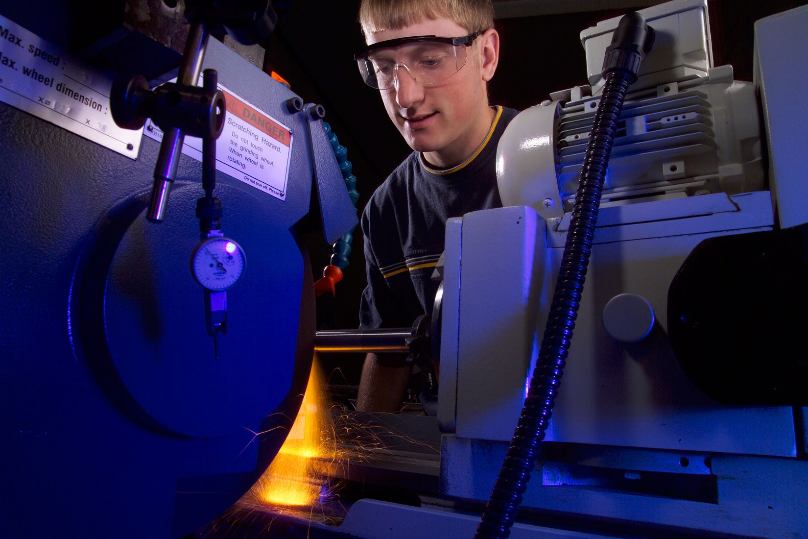 Student using a CNC machine during class at Hawkeye Community College