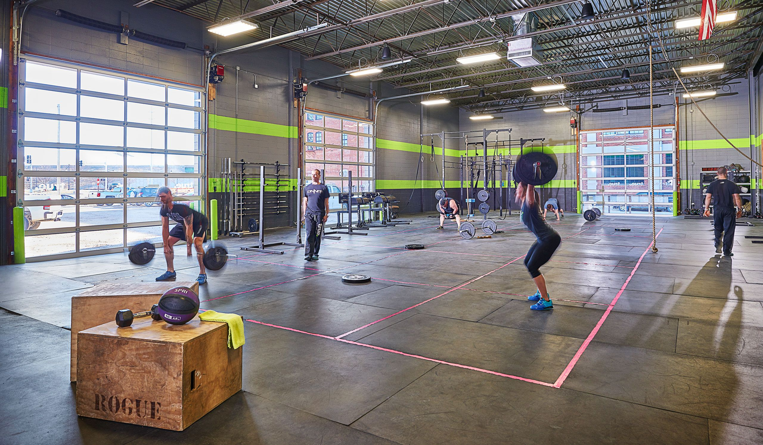 People working out with free weights at True Fitness