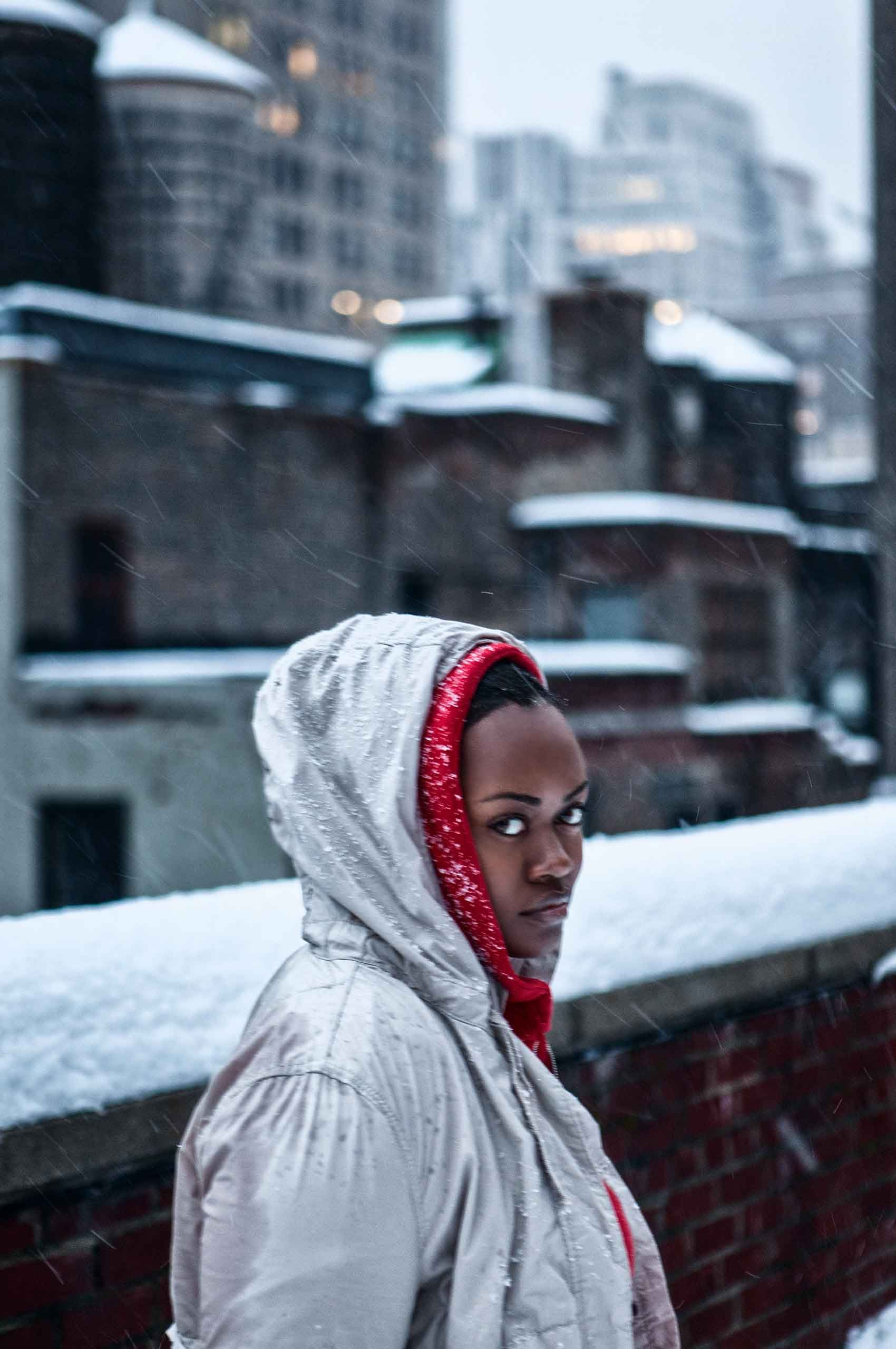 africanamerican-young-woman-on-snowy-rooftop-by-HenrikOlundPhotography.jpg