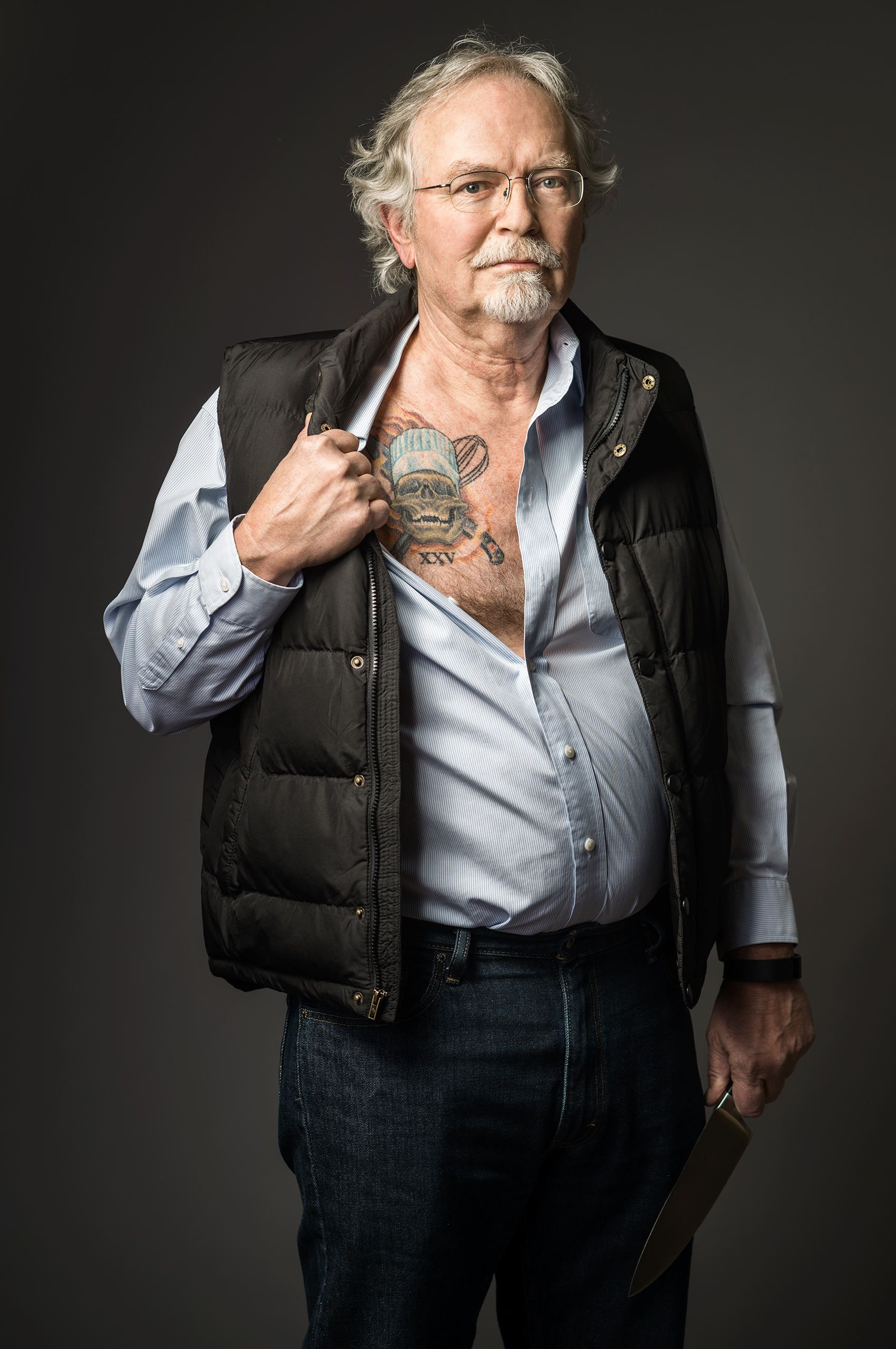man-showing-tattooo-by-HenrikOlundPhotography.jpg