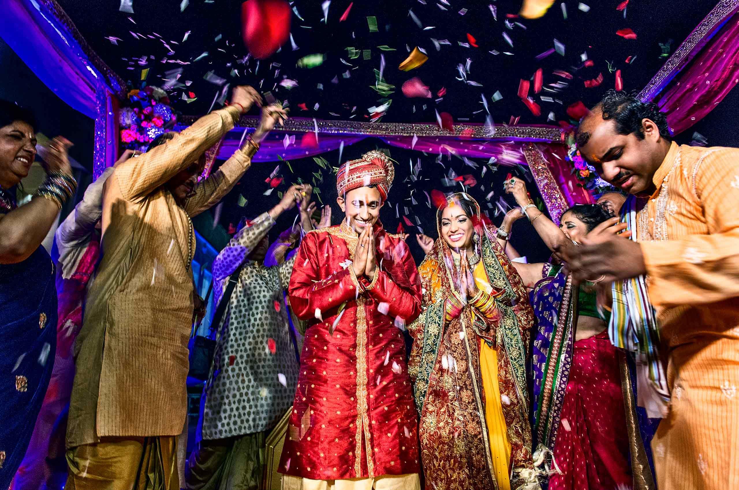 indianweddingcouple-with-confetti-by-HenrikOlundPhotography.jpg