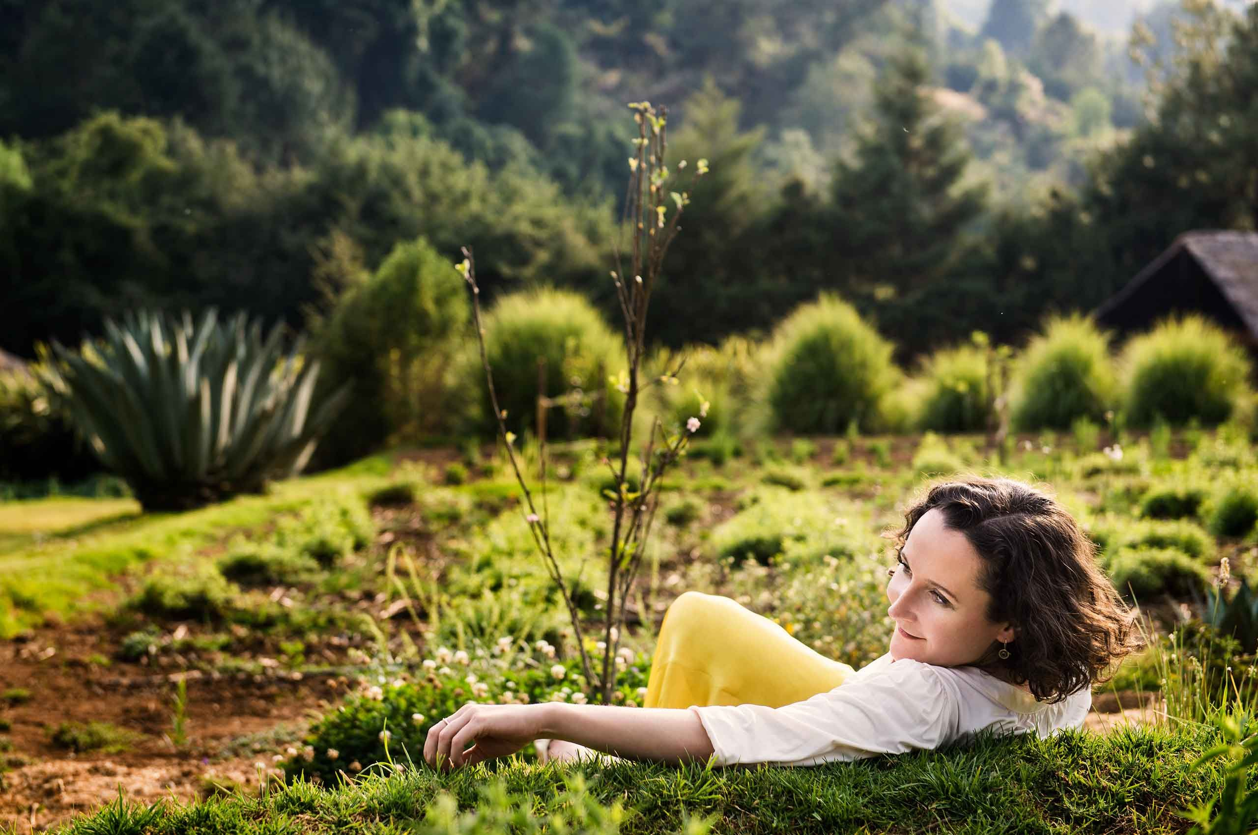 Woman-Lounging-in-MorningSun-in-nature-by-HenrikOlundPhotography.jpg