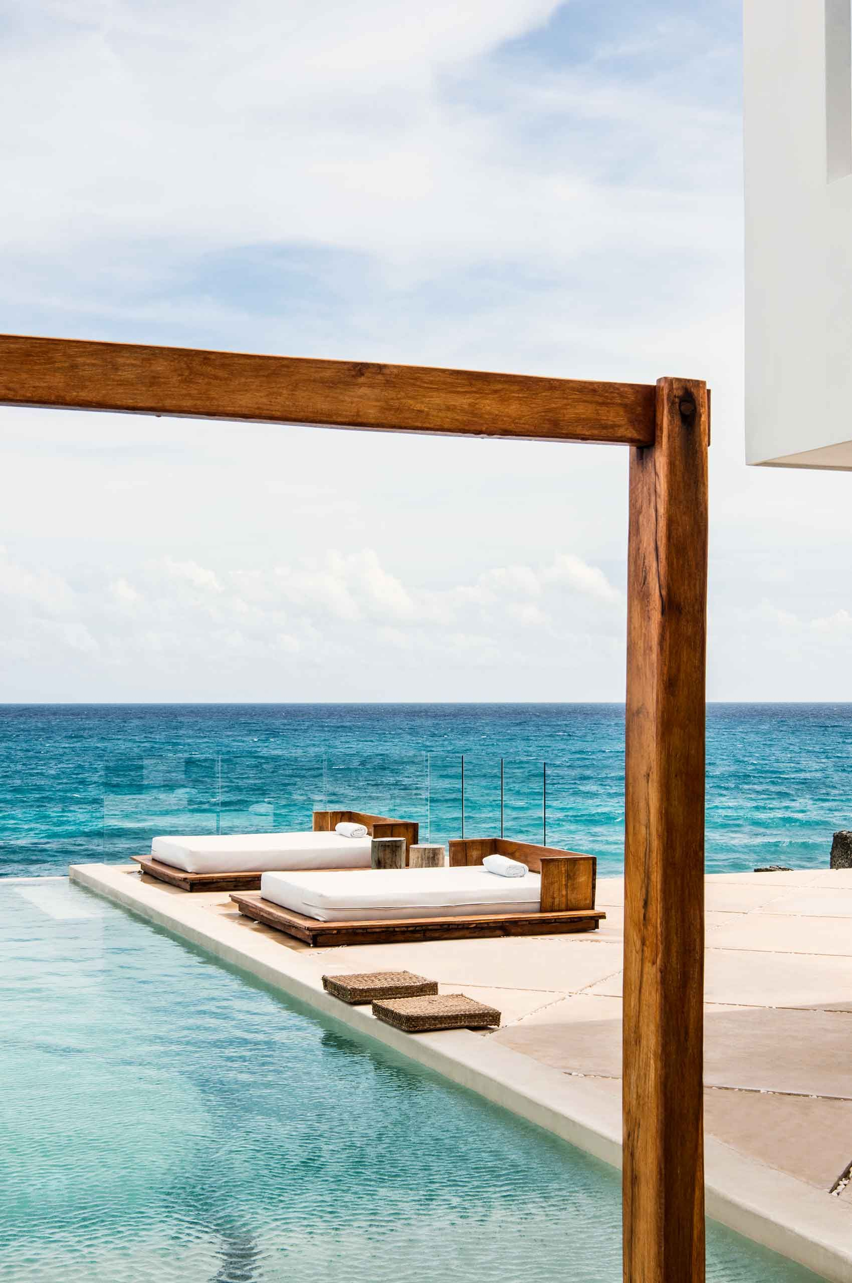 Loungebeds-by-pool-at-ocean-by-HenrikOlundPhotography.jpg