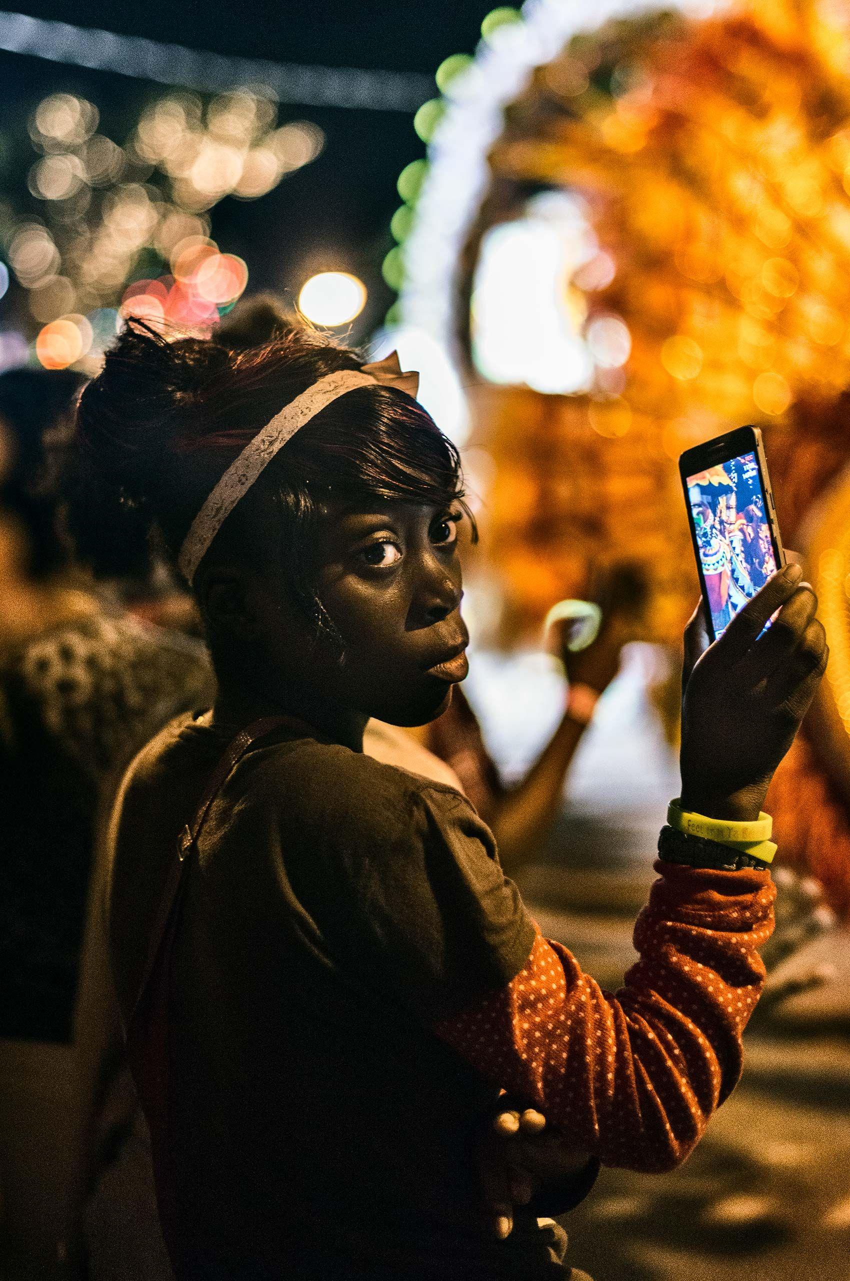 woman-with-cellphone-junkeroo-parade-harborisland-HenrikOlundPhotography.jpg