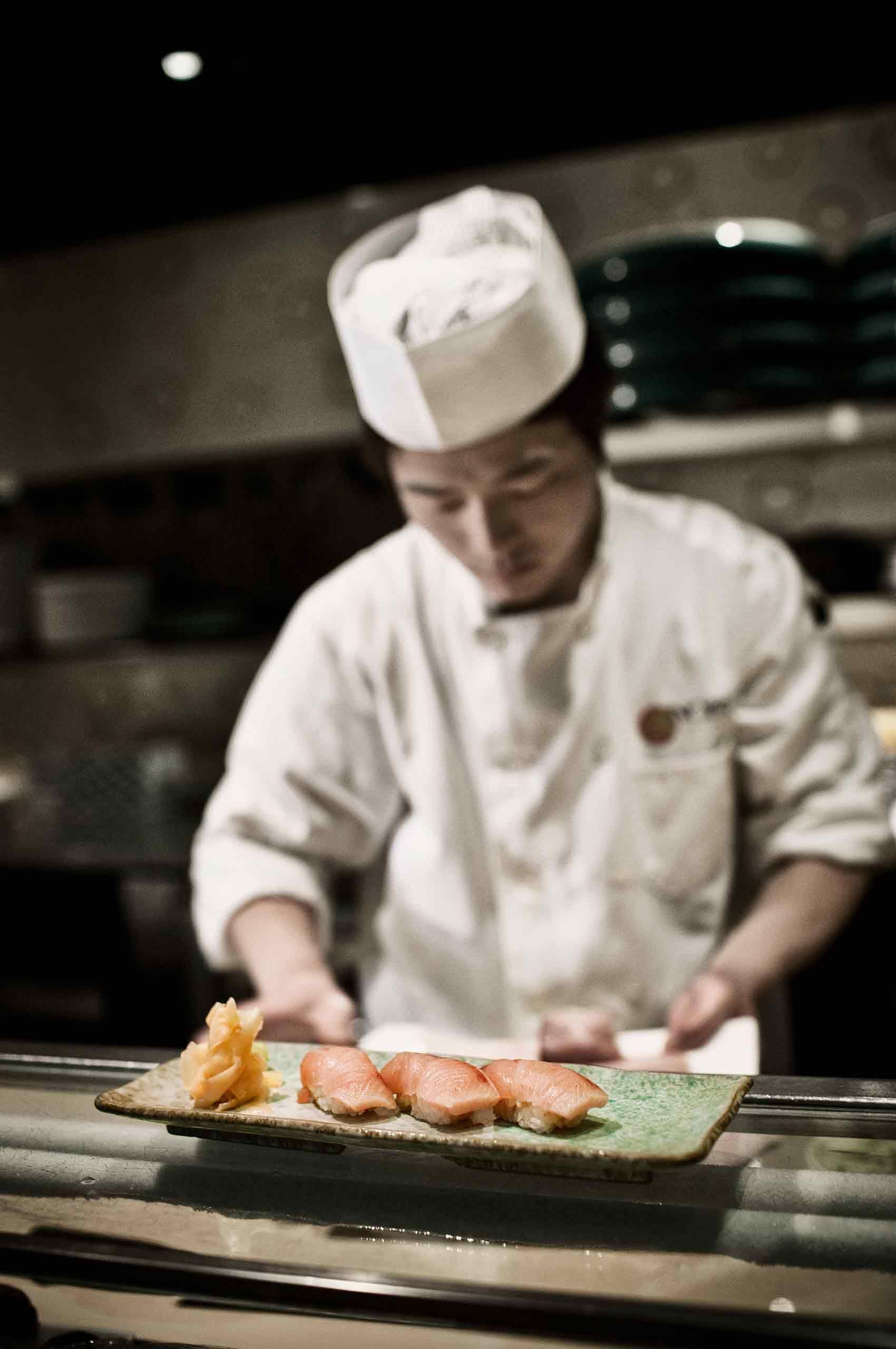 Sushichef-preparing-sushi-by-HenrikOlundPhotography.jpg