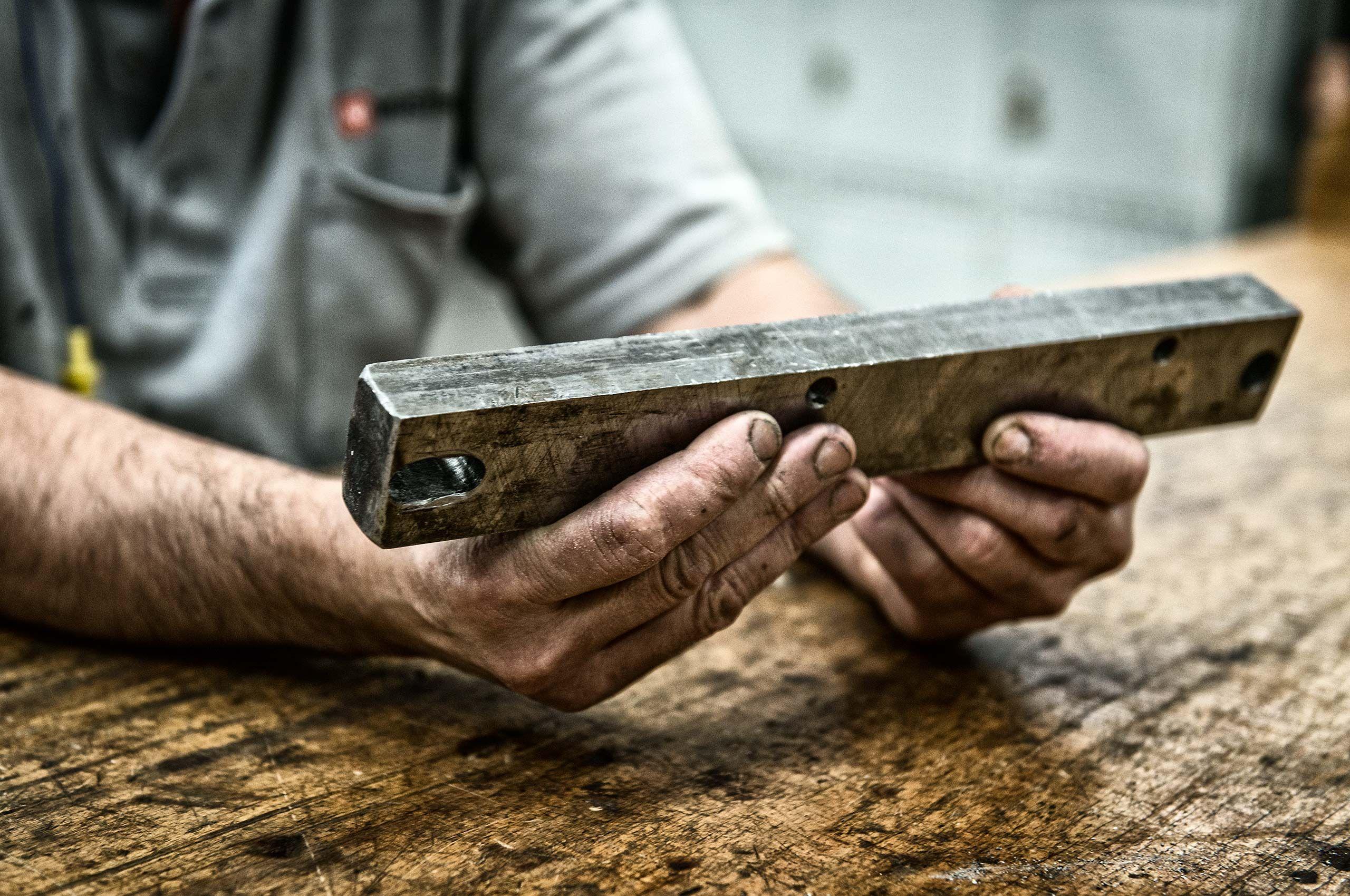 factory-hands-holding-metal-wusthof-factory-HenrikOlundPhotography.jpg