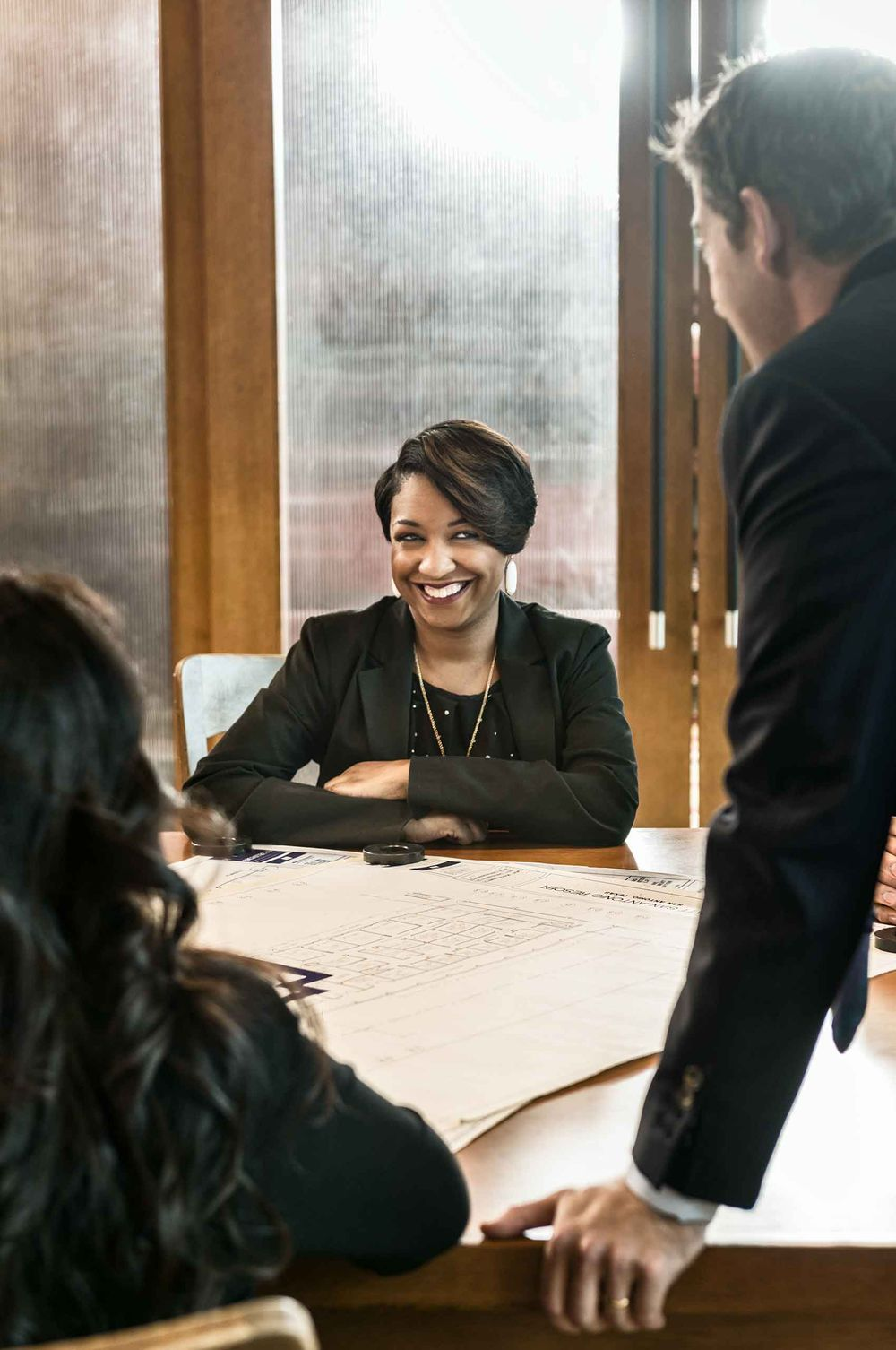 Smiling-woman-in-Businessmeeting-by-HenrikOlundPhotography.jpg