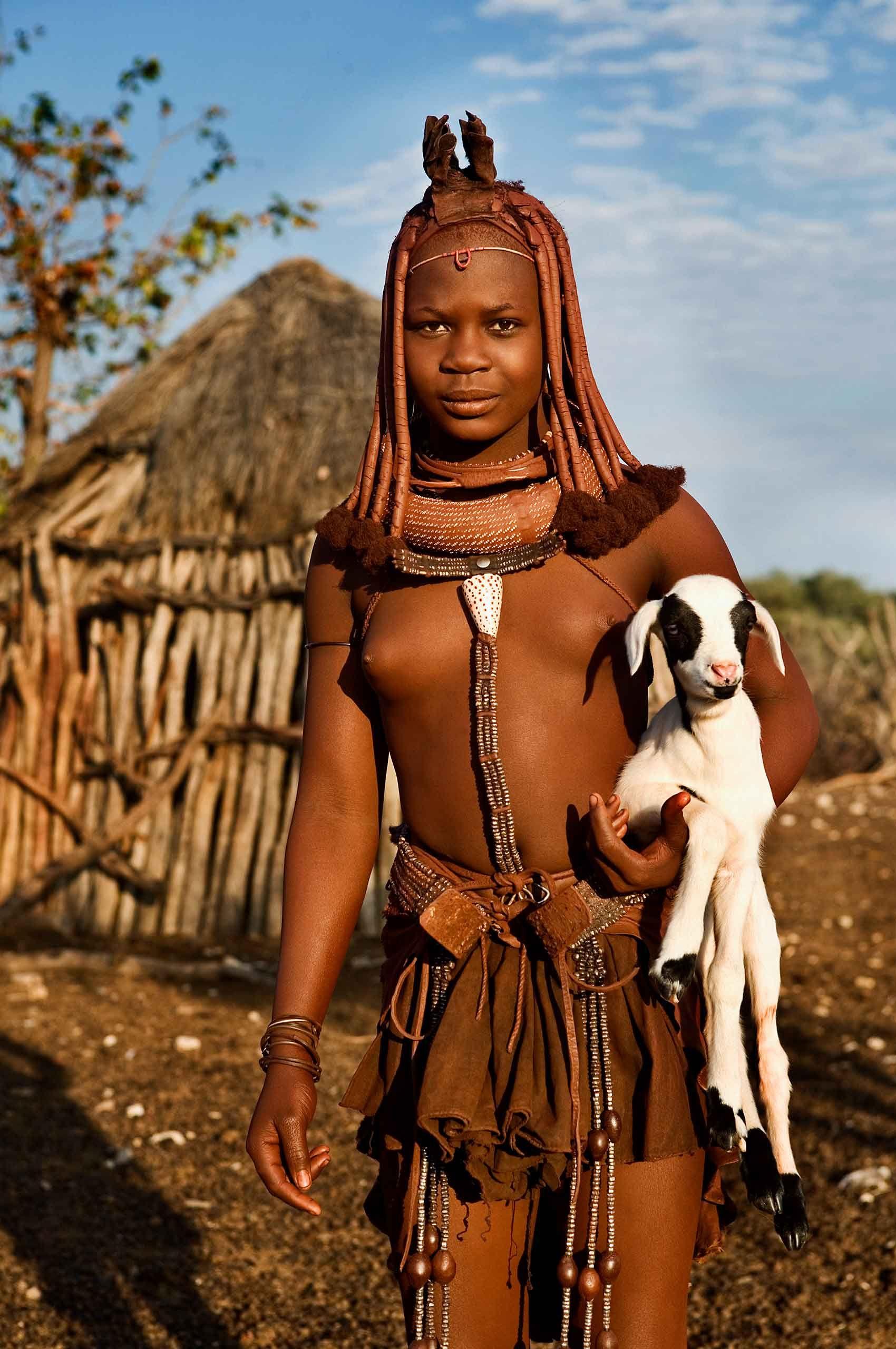himba-girl-with-lamb-namibia-by-henrikolundphotography.jpg