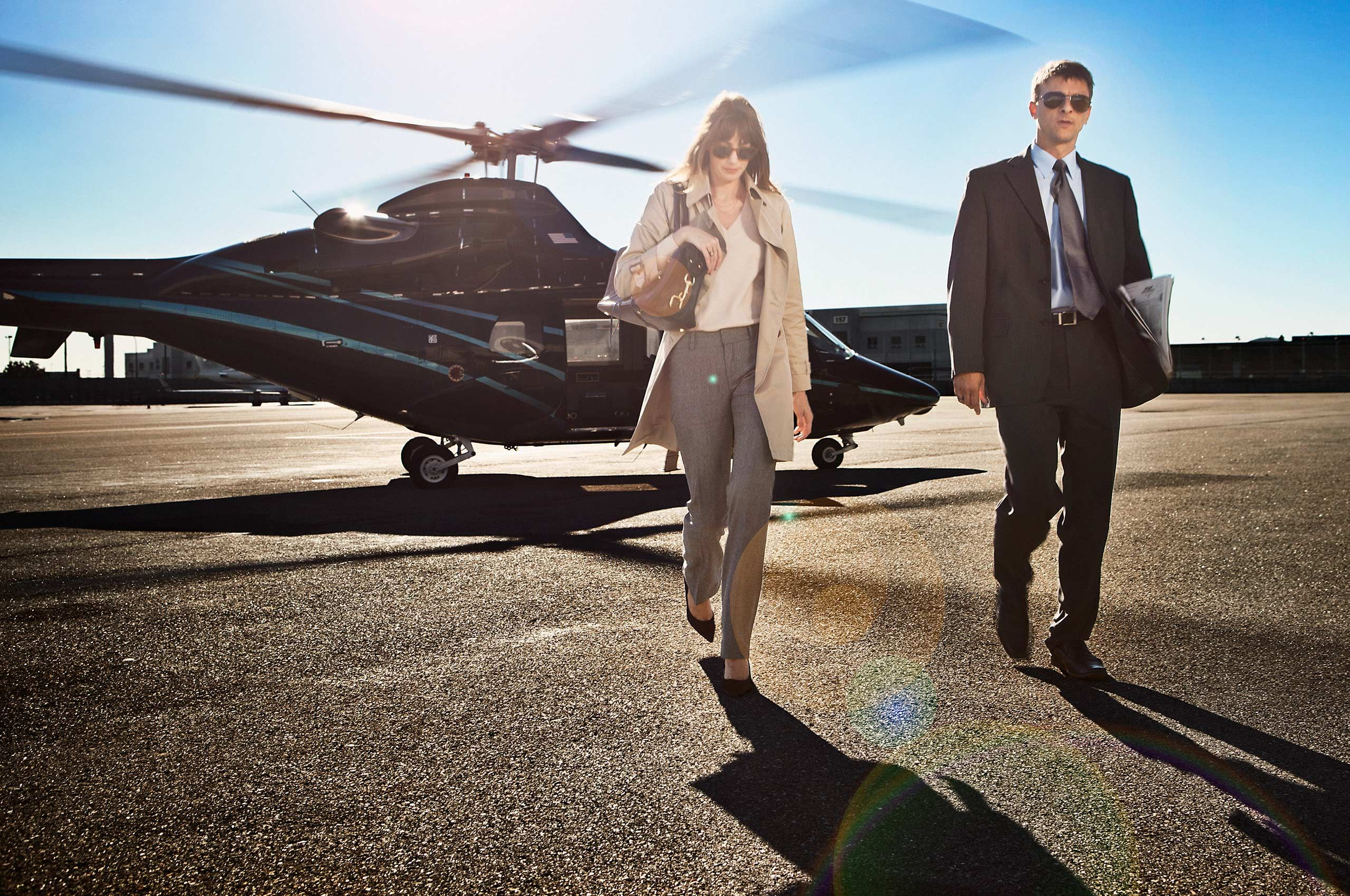 Couple-exiting-chartered-helicoper-HenrikOlundPhotography.jpg