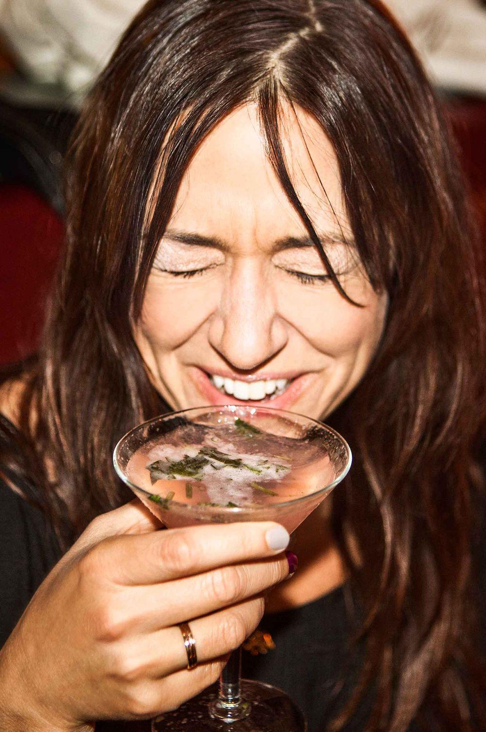 Laughing-Woman-drinking-martini-by-HenrikOlundPhotography..jpg