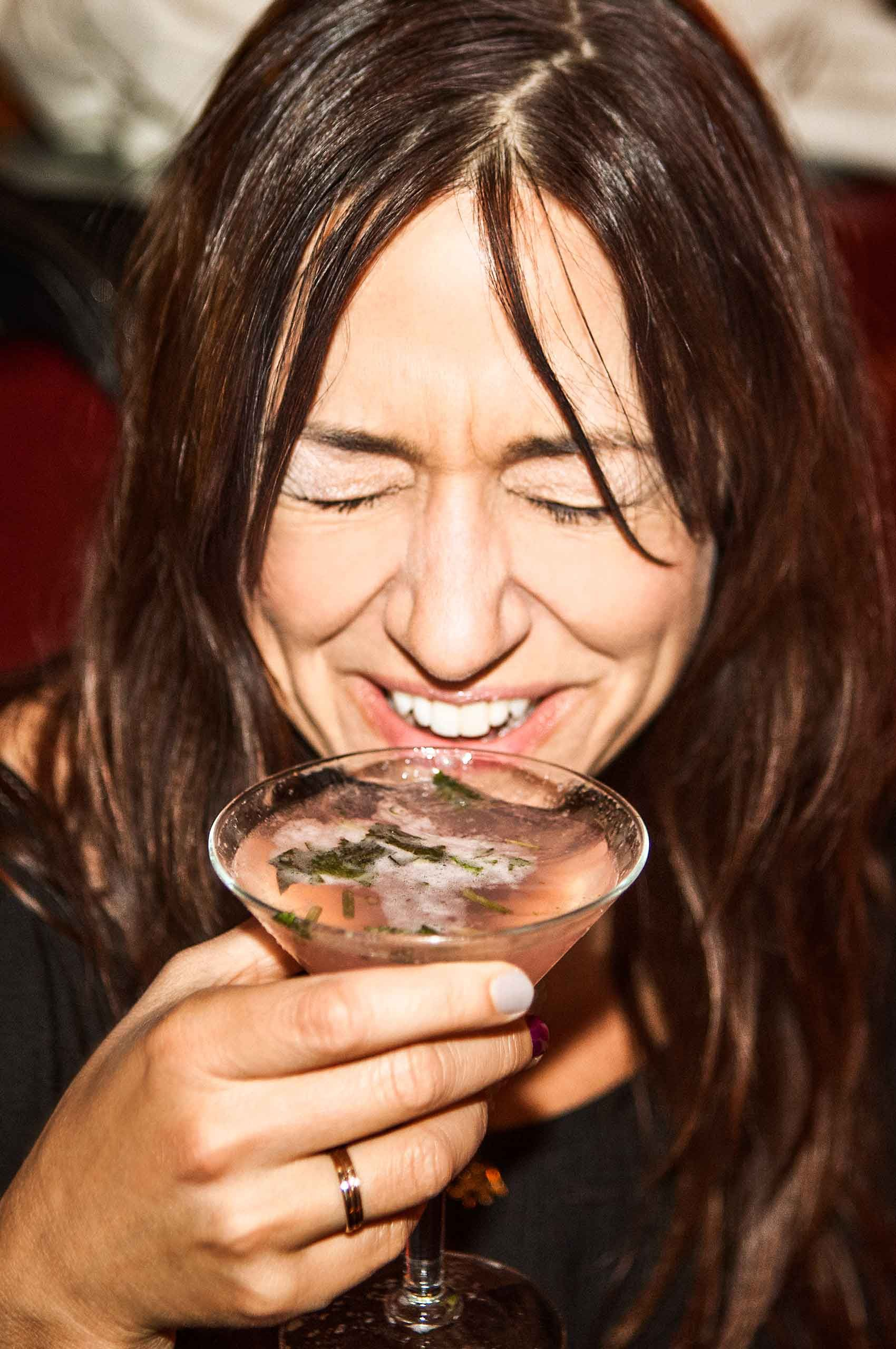 Laughing-Woman-drinking-martini-by-HenrikOlundPhotography..jpg