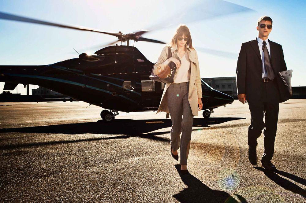 Businesswoman-exiting-helicoper-by-HenrikOlundPhotography.jpg