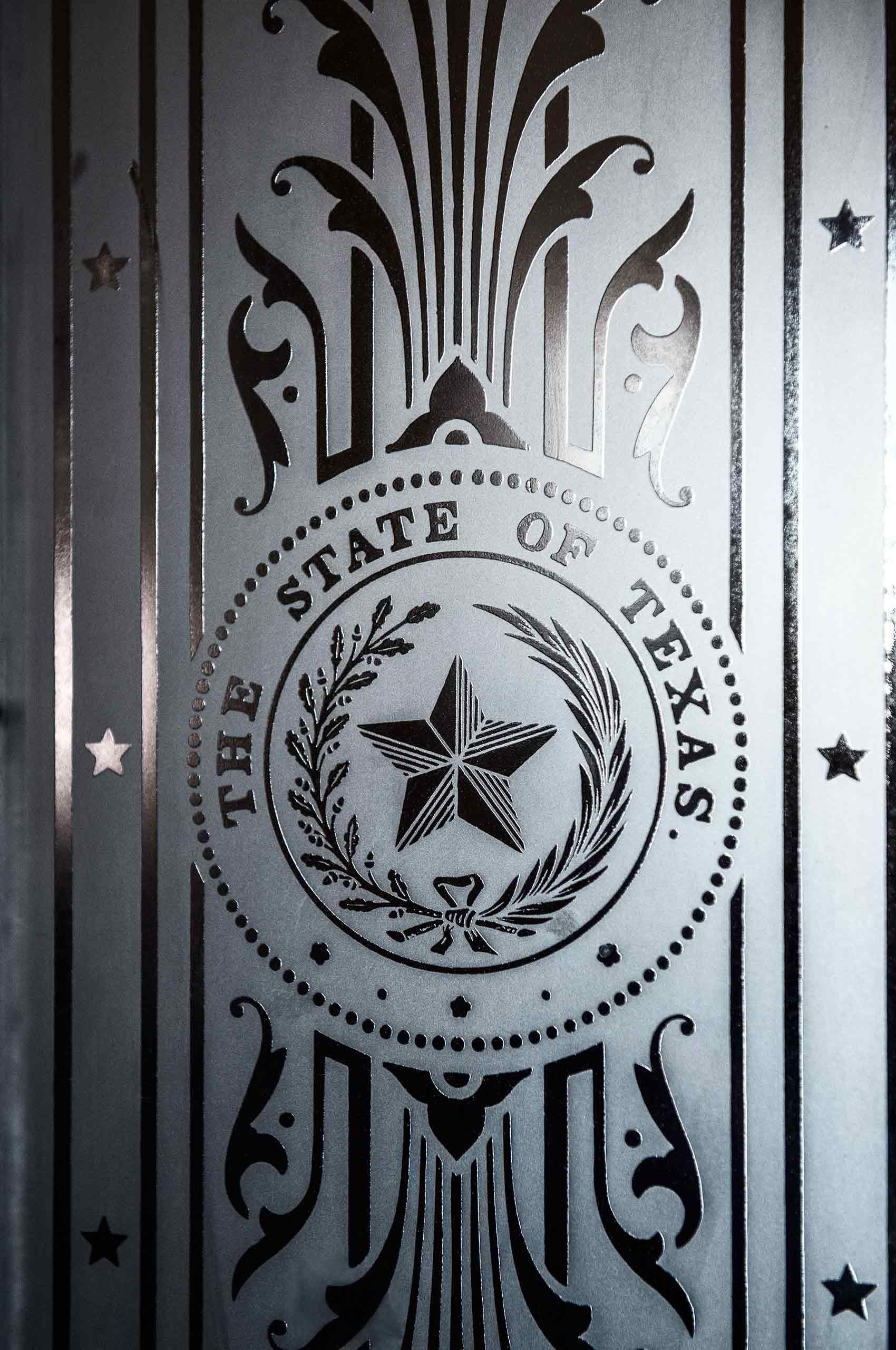 StateOfTexas-Emblem-GlassDoor-Austin-CapitolBuilding-by-HenrikOlundPhotography.jpg