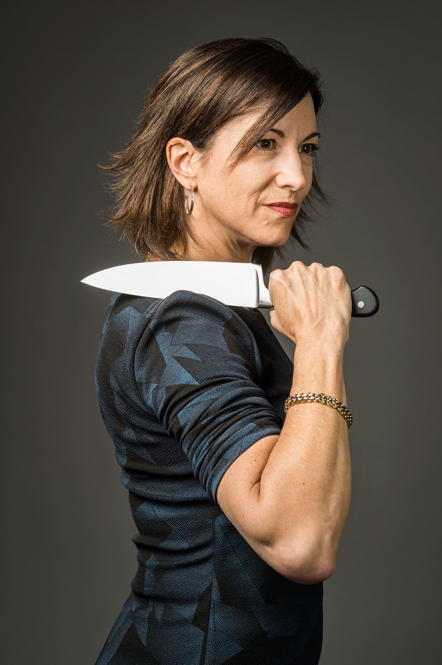 woman-holding-knife-by-HenrikOlundPhotography.jpg