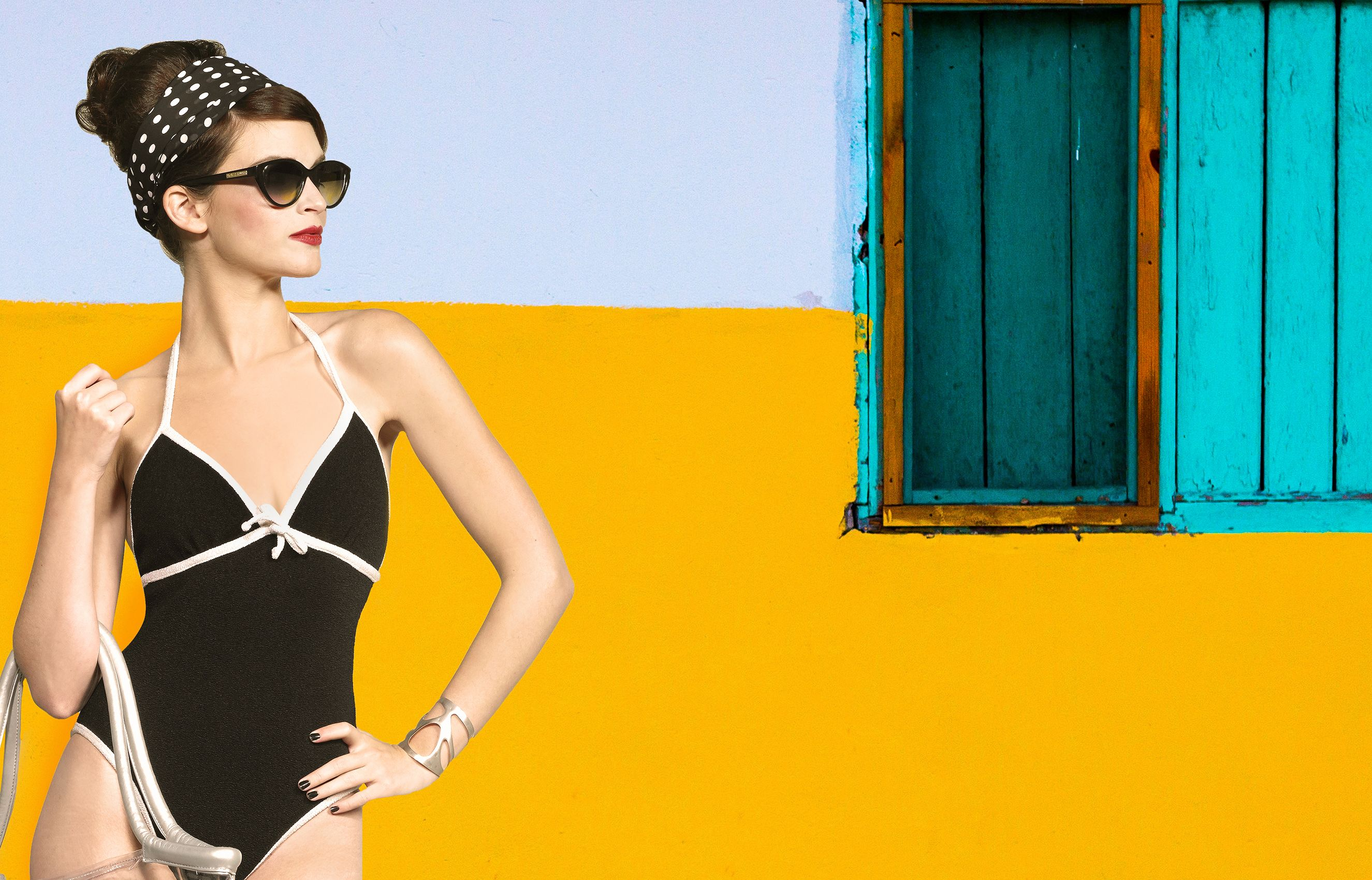 Model in swimsuit at yellow wall.jpg