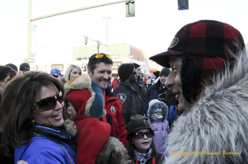 Sarah Palin, Todd & family talking with Martin Buser before ceremonial start in Anchorage, AK