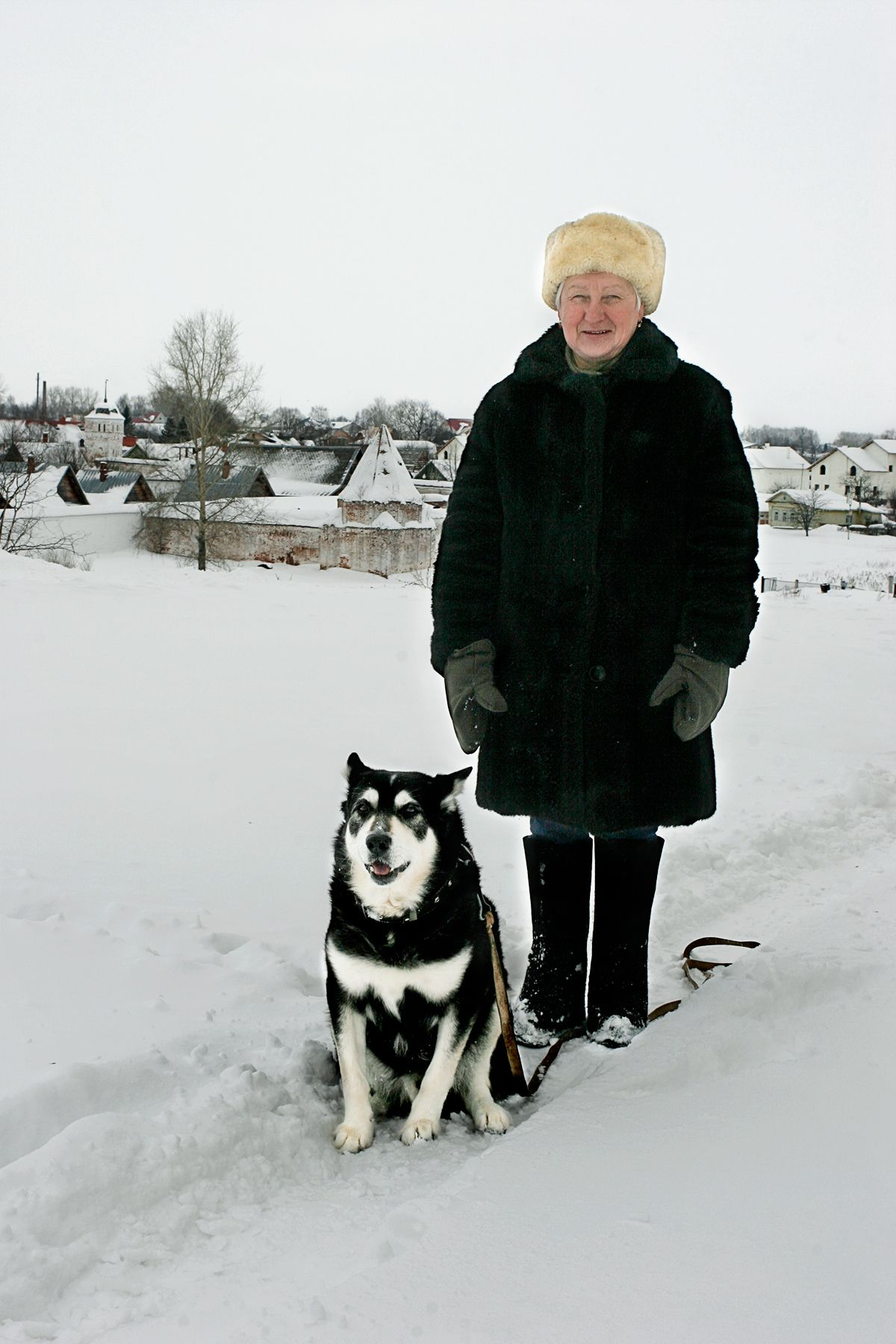 Russian Woman walking a Dog