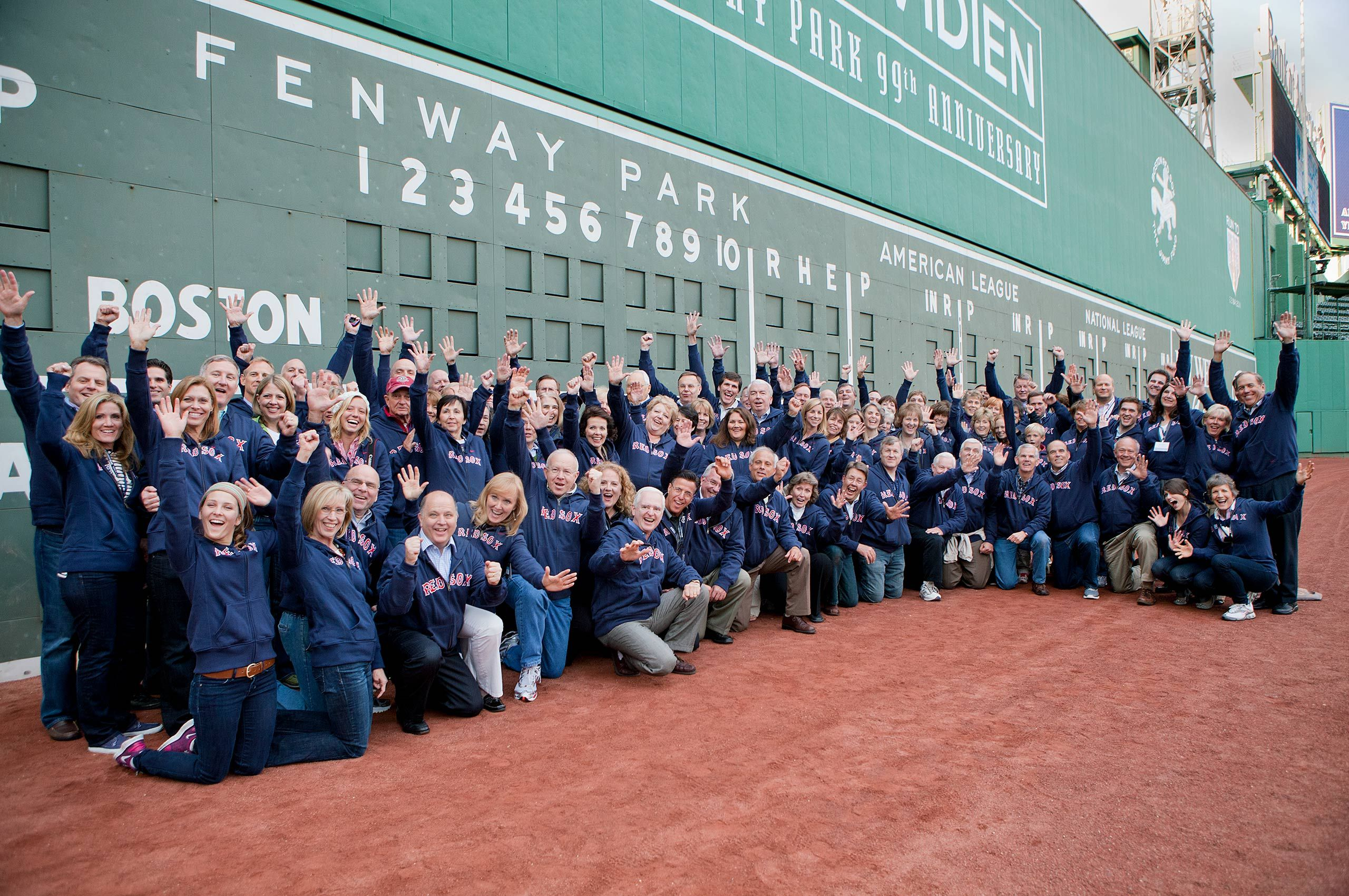 Group Picture in front of the Green Monster Wall at Fenway Park