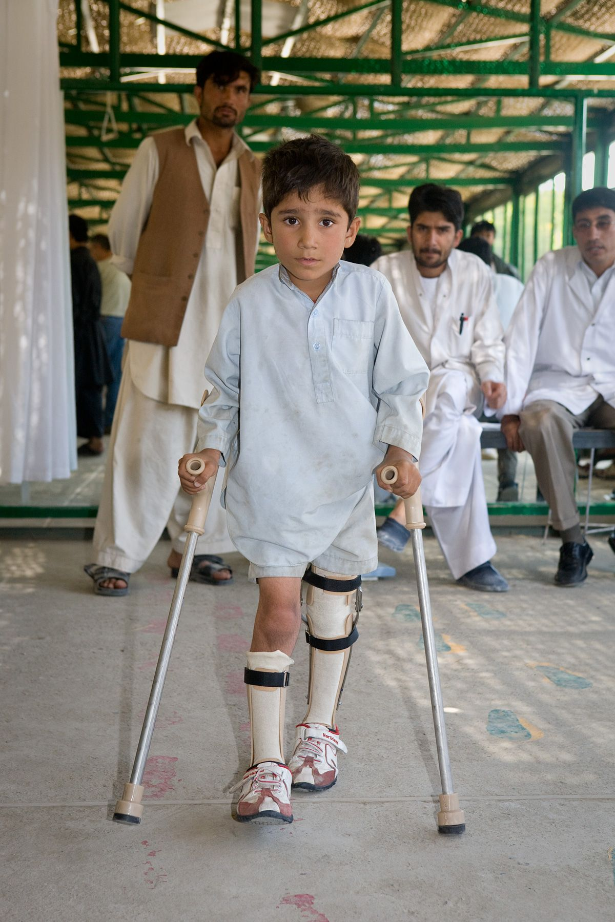 An Afghan Boy on Crutches