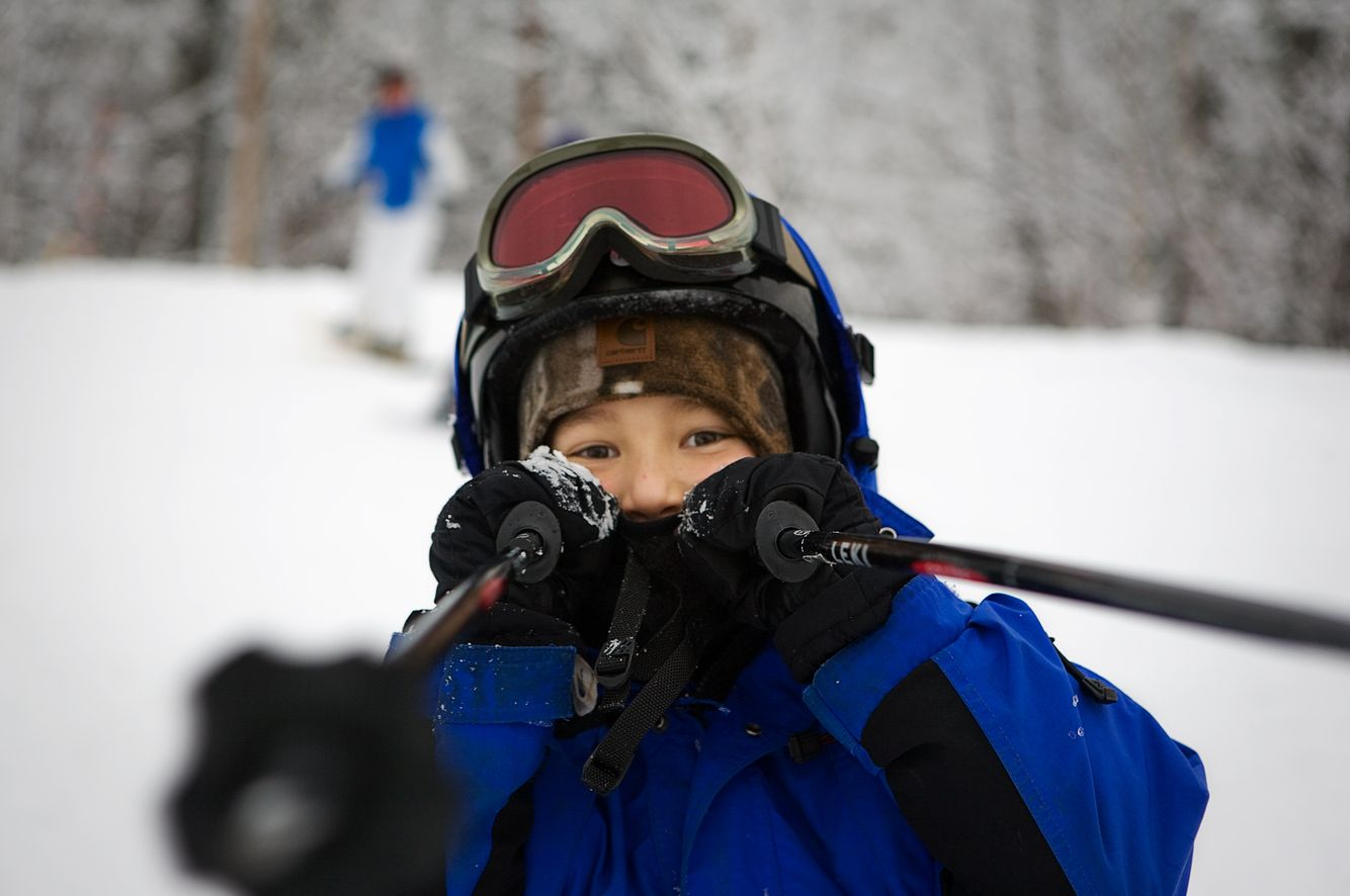 Young Skier Playing with Poles