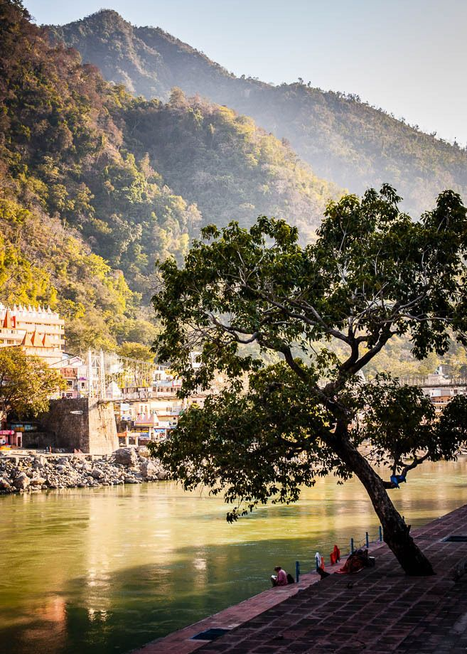 1people_relaxing_by_ganges_in_lakshman_jhula_india