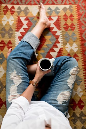 Holding coffee on a rug