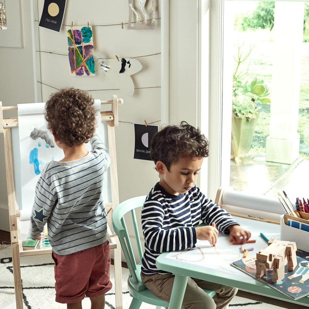 two little boys creating art