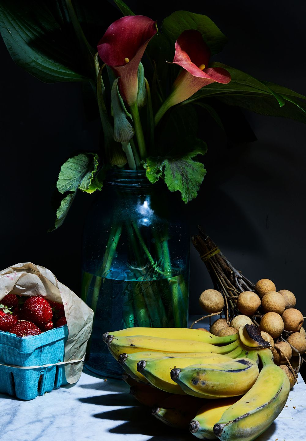 Lillies and fruit on tabletop