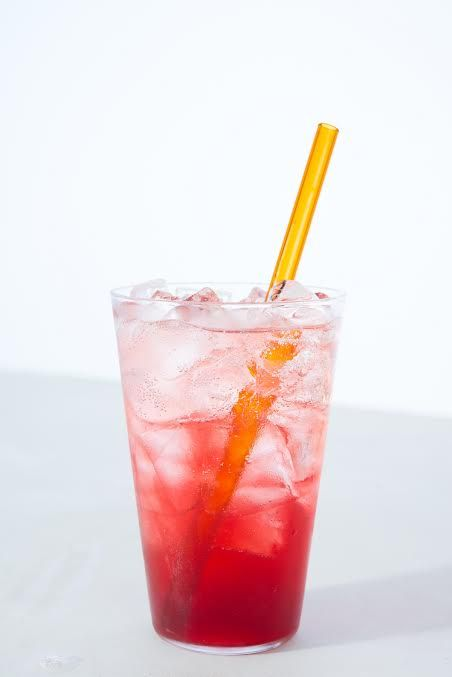 Pink ombre soda with yellow straw