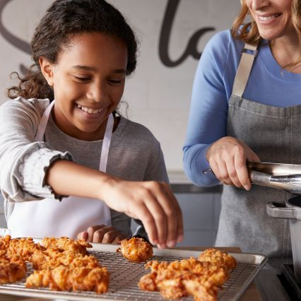 Chefs bake fried chicken advertising image Sur La Table