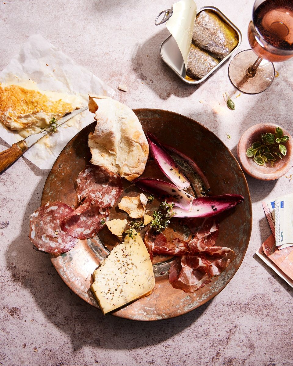 charcuterie with endive and pita in a bowl